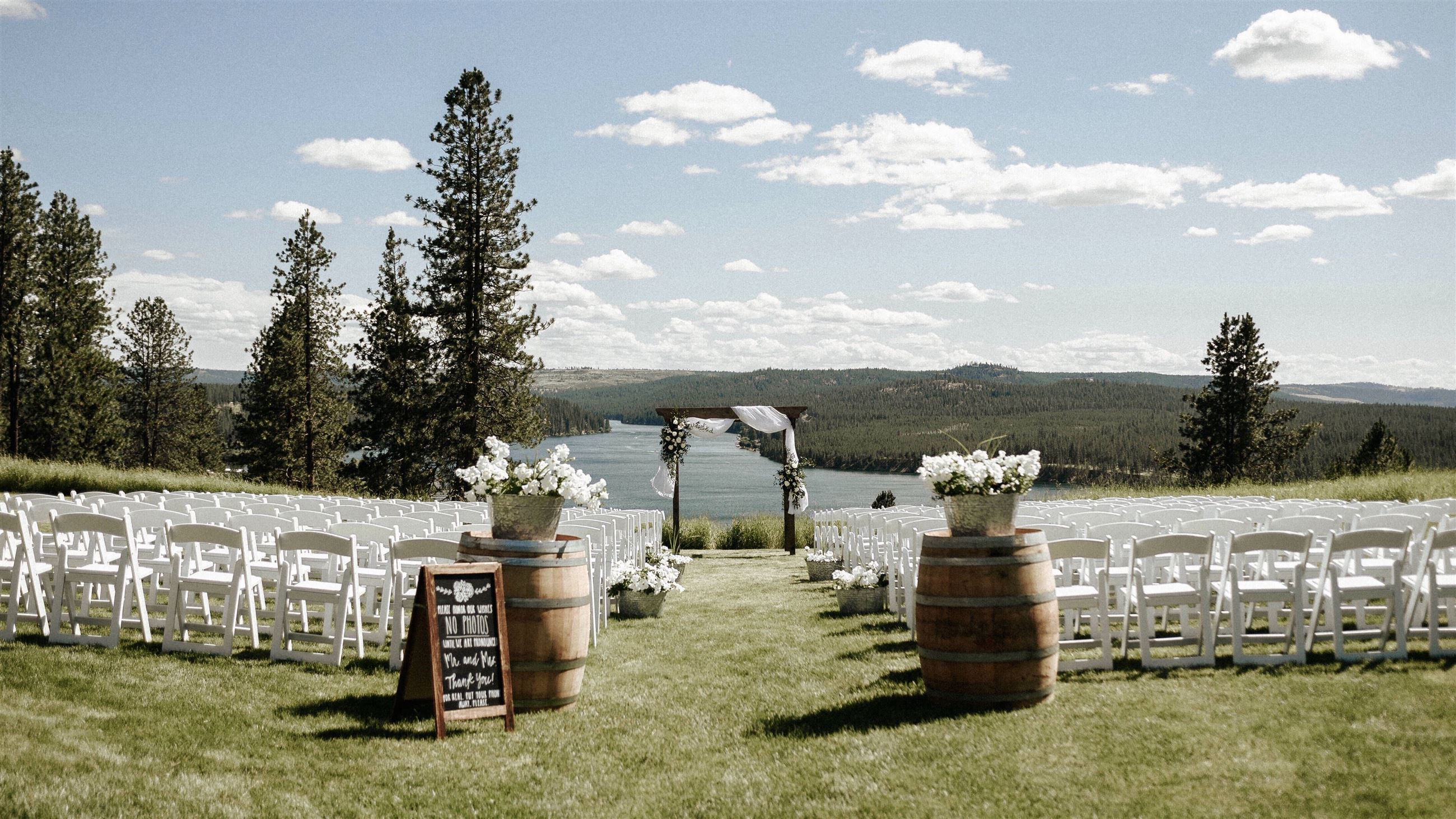 wedding venue overlooking a lake and mountains