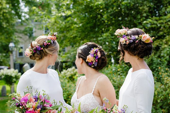 bride and bridesmaids showing their floral crowns