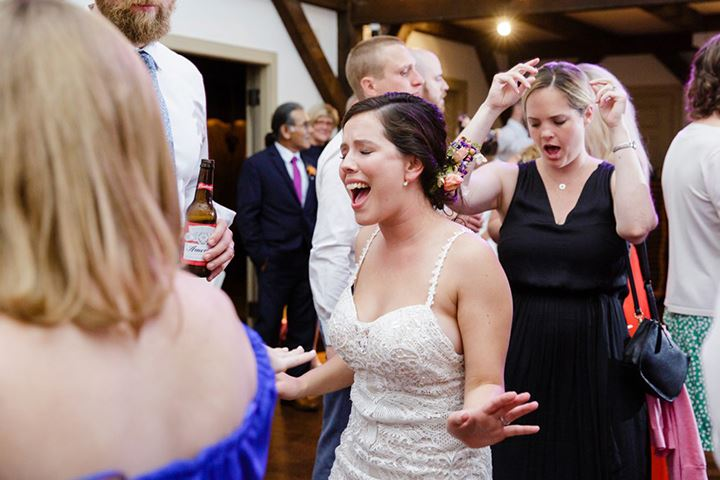 bride singing with her guests at reception